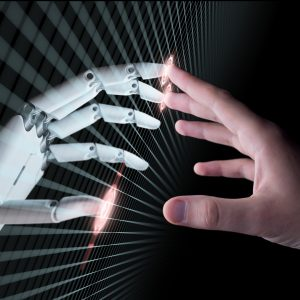 artificial intelligence shown through a human hand touching a robot hand